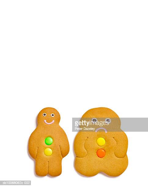Two gingerbread cookies on white background, close-up