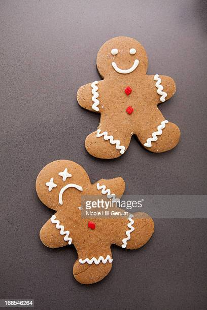 Two gingerbread men on grey background