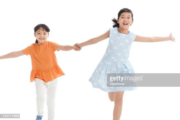 Two girl hand in hand running