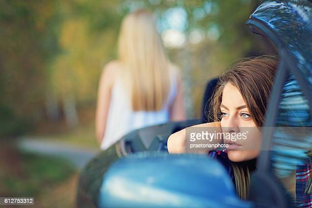 Two girlfriends are standing upset on the road