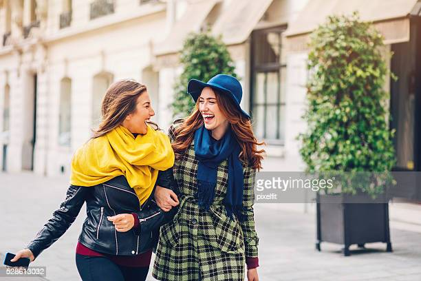 Two girlfriends walking on the streets of Paris