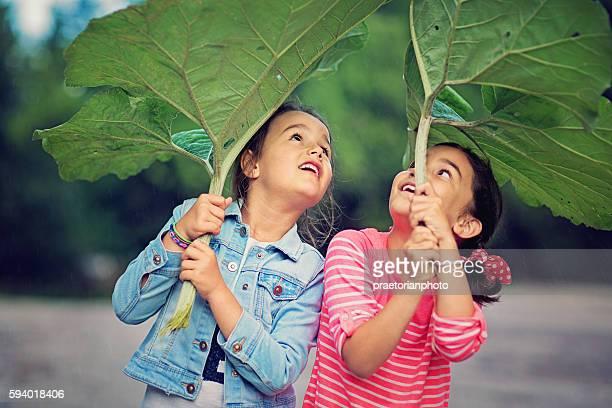 Two girls are enjoying the starting rain
