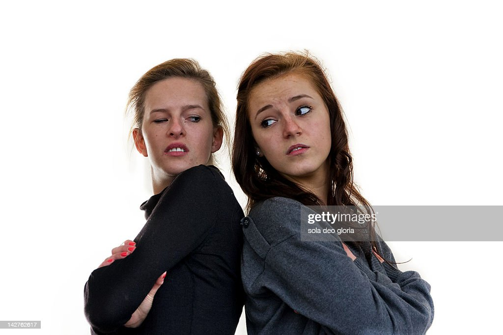 Two girls arguing agianst white background : Stock Photo