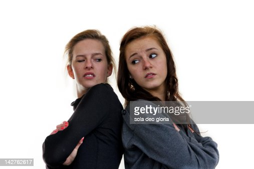 Two girls arguing agianst white background : Foto stock