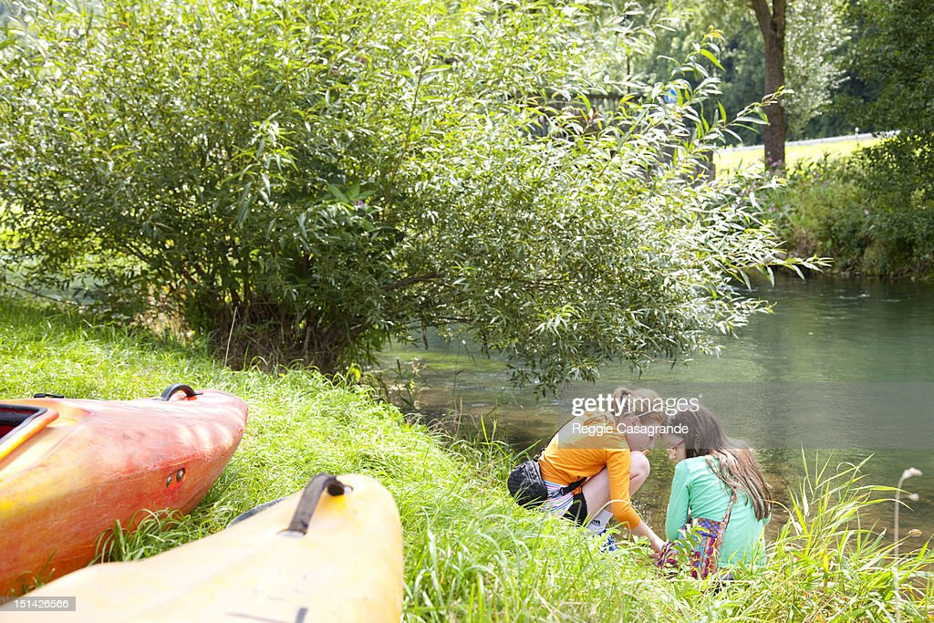 Two girls beside a lake : Stock Photo