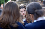 Two girls (12-13) bullying other school girl (10-11), differential focus