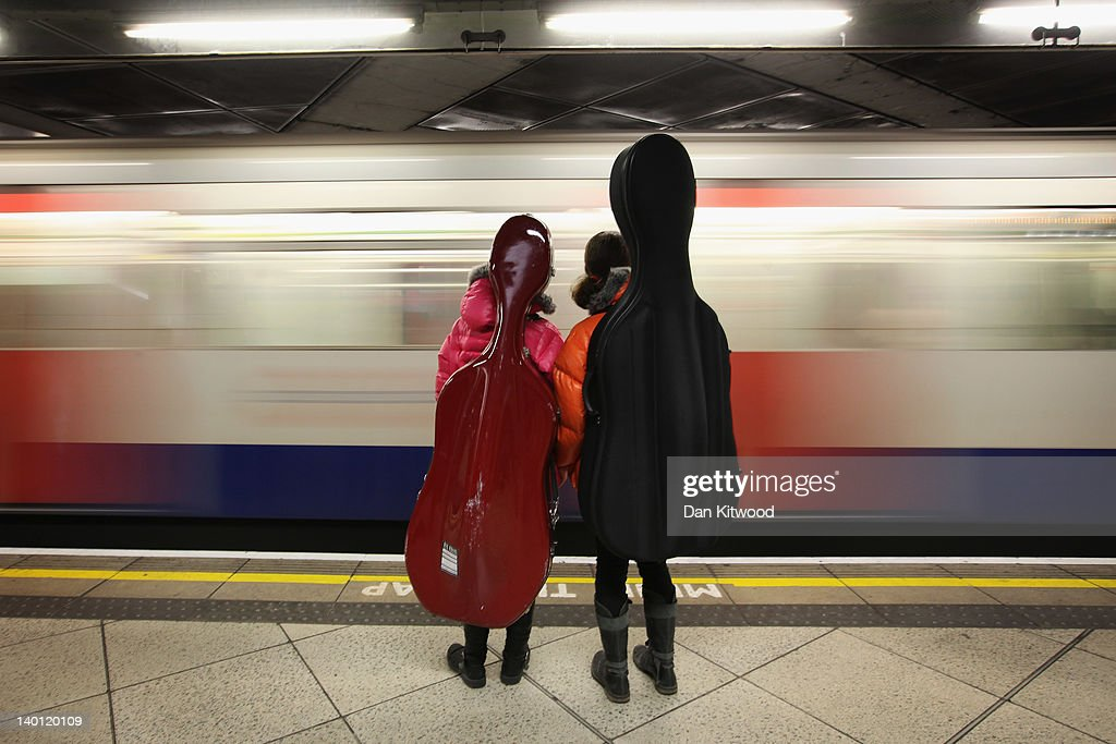 Two girls carrying Cellos wait for a train on London Underground's Westminster Station on February 28, 2012 in London, England. London's Underground system is the oldest of it's kind in the World, and carries approximately a quarter of a million people around it's network every day.