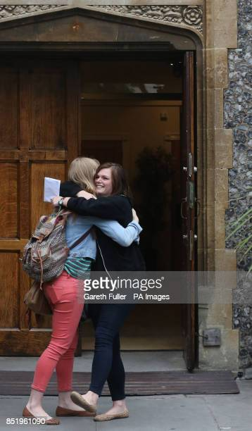 Two girls celebrate their results at Brighton College in East Sussex as students receive their A Levels results across the country