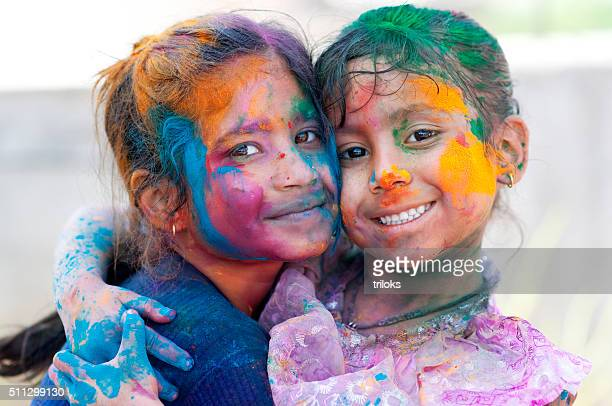 Two girls celebrating holi