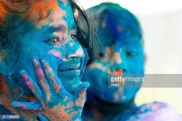 Two girls celebrating holi