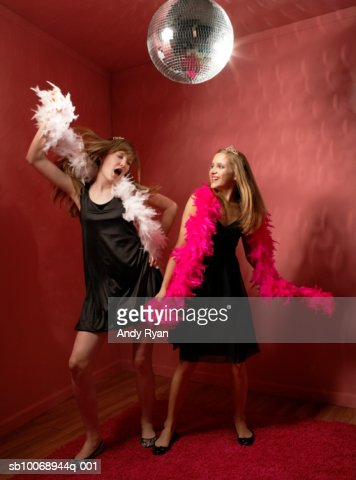 Two girls (12-13) dancing under disco ball