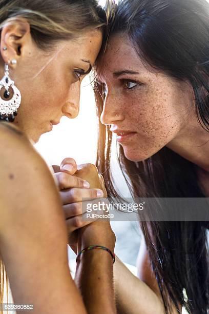 Two girls doing arm wrestling
