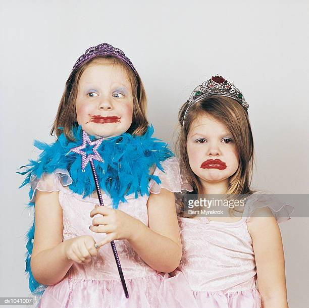 Two Girls Dressed Up as Princesses with Messy Lipstick