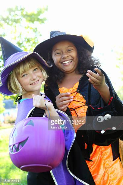 Two girls dressed up as witches for Halloween