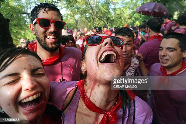 Two girls drink wine as they enjoy the'Batalla del Vino' in Haro on June 29 2015 Every year thousands of locals and tourists climb a mountain in the...