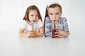 Two Girls Drinking Fruit Smoothies