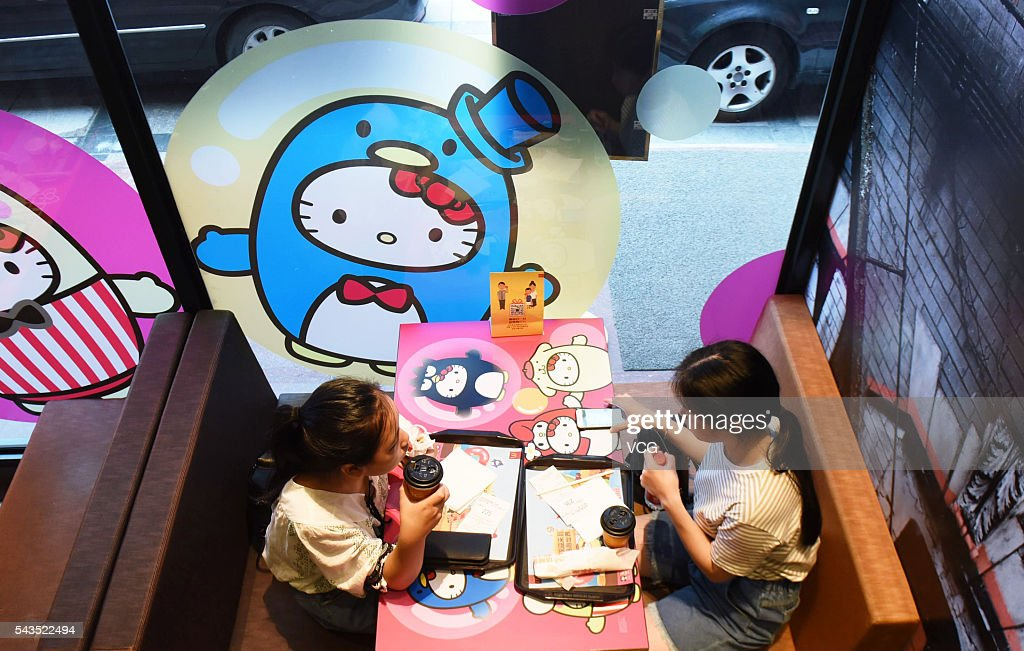 Two girls eat at a Hello Kitty theme restaurant on June 29, 2016 in Hangzhou, Zhejiang Province of China. A Hello Kitty theme restaurant was authorized opened firstly in Hangzhou.