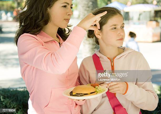 Two girls eating fast food