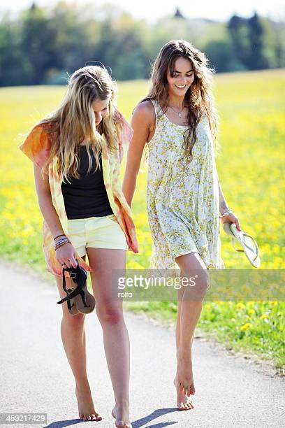 Two girls having fun walking barefoot