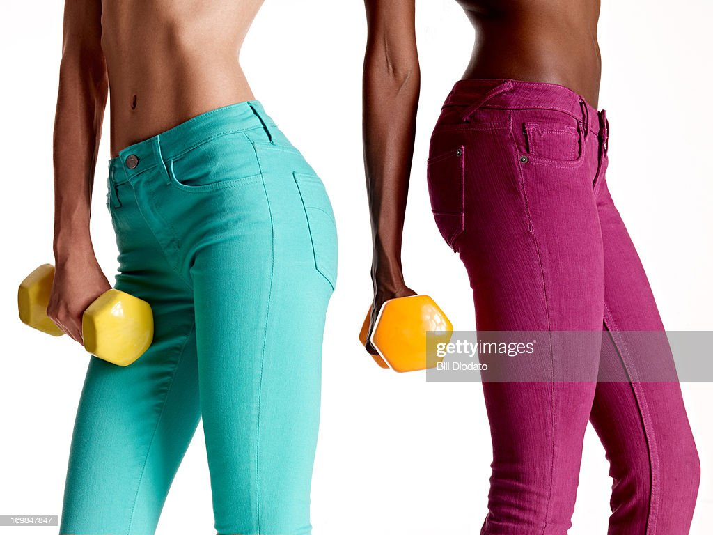 two girls holding dumb bells : Stock Photo