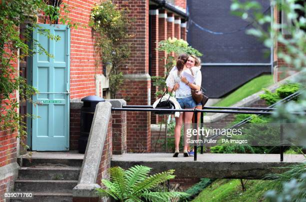 Two girls hug as they celebrate their A Level exam results at Brighton College in Brighton East Sussex