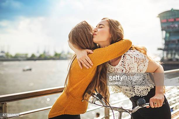 Two girls hug at meeting