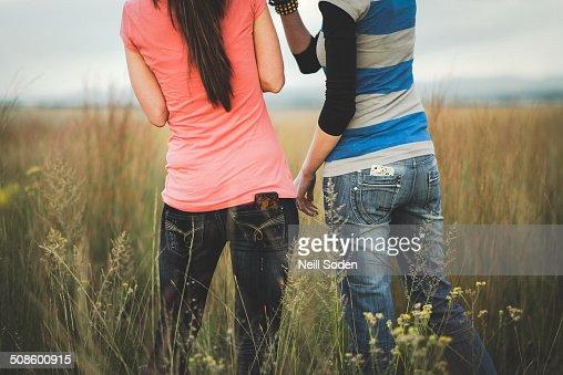 Two girls in a field : Foto de stock