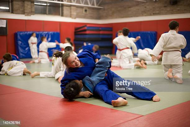 Two girls in a Judo lesson.