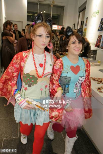 Two girls in Anime costumes at the gallery opening for Kaiju Monster Invasion at Art Center South Florida