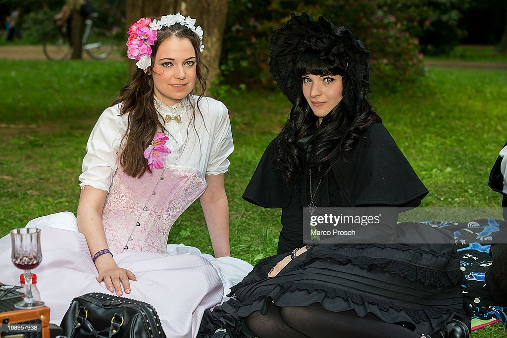 Two girls in black and white Victorian clothing pose for pictures during the traditional park picnic on the first day of the annual Wave-Gotik Treffen, or Wave and Goth Festival, on May 17, 2013 in Leipzig, Germany. The four-day festival, in which elaborate fashion is a must, brings together over 20,000 Wave, Goth and steam punk enthusiasts from all over the world for concerts, readings, films, a Middle Ages market and workshops.