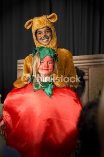 Two Girls In Costumes Performing On Stage Smiling Portrait Photo