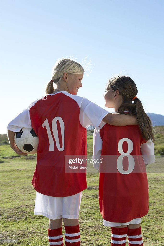 Two girls in football kit : Stock Photo