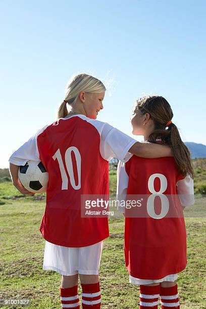 Two girls in football kit