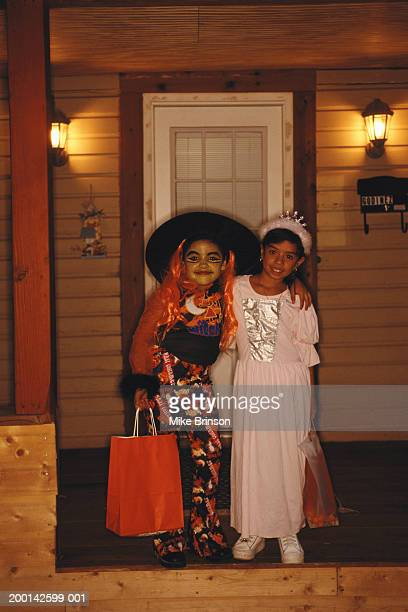 Two girls (10-12) in halloween costume, portrait