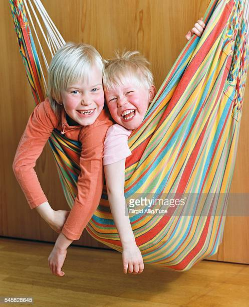 Two Girls in Hammock Laughing
