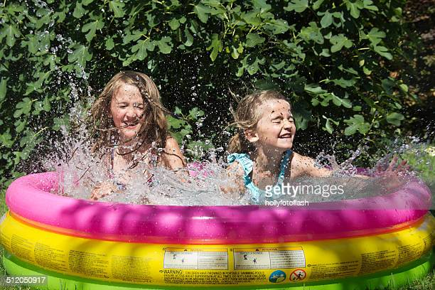 Two girls in the paddling pool