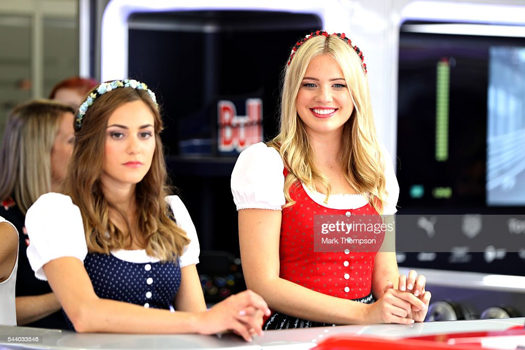 Two girls in traditional Austrian dirndl dresses watch the action in the Red Bull Racing garage during practice for the Formula One Grand Prix of Austria at Red Bull Ring on July 1, 2016 in Spielberg, Austria.