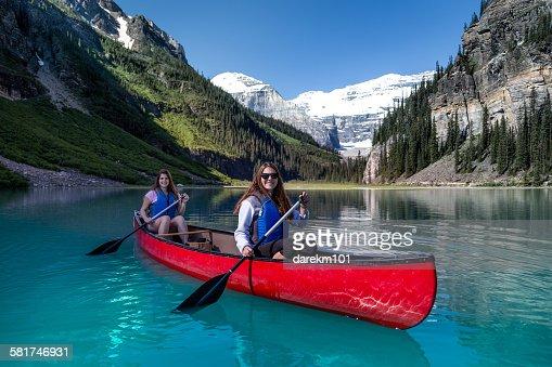 Two girls kayaking, Lake Louise, Banff National Park, Alberta, Canada