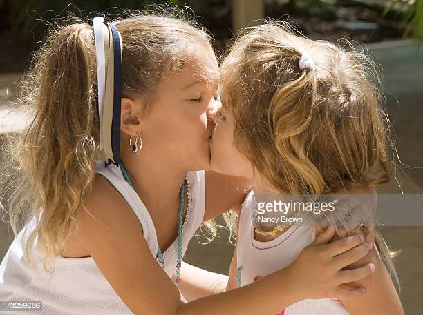 Two girls (2-5) kissing
