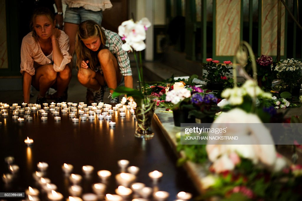 Two girls leave candles inside Oslo Cathedral on July 28 to honor the 76 victims of the July 22 attacks in the Norwegian capital and on the island of...