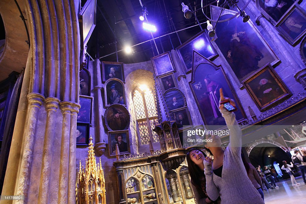 Two girls look around the set of Dumbledore's office at the new Harry Potter Studio Tour at the Warner Brothers Leavesden Studios on March 23, 2012 in London, England. The studio includes the actual sets and special effects departments where the films were created and shot and goes on public display on March 31, 2012.