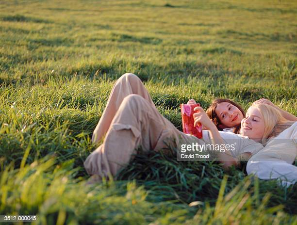 Two Girls Lying in Field