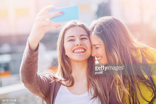 Two girls making selfie