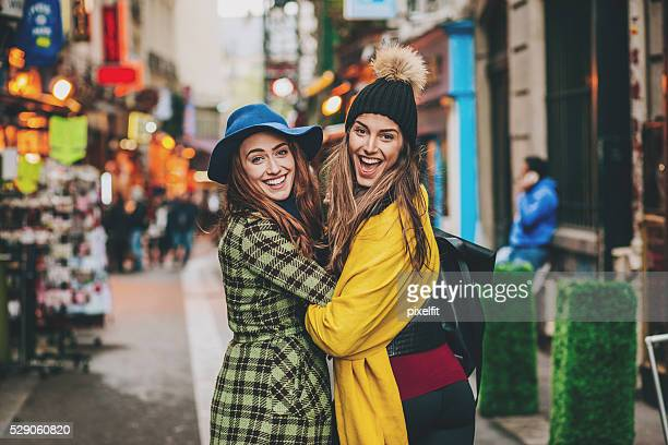 Two girls on a shopping street in Paris city