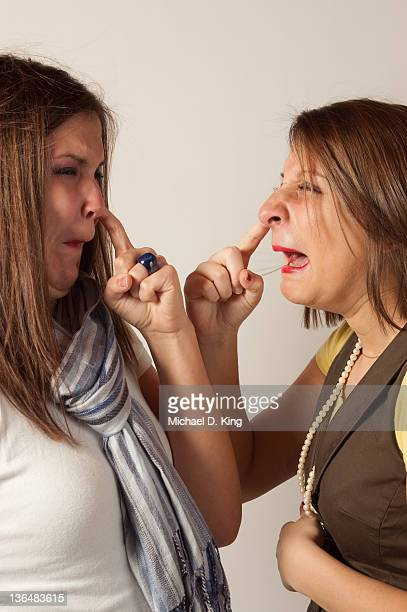 Two girls picking their noses