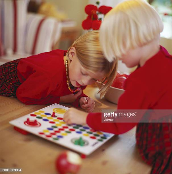 Two Girls Play Ludo