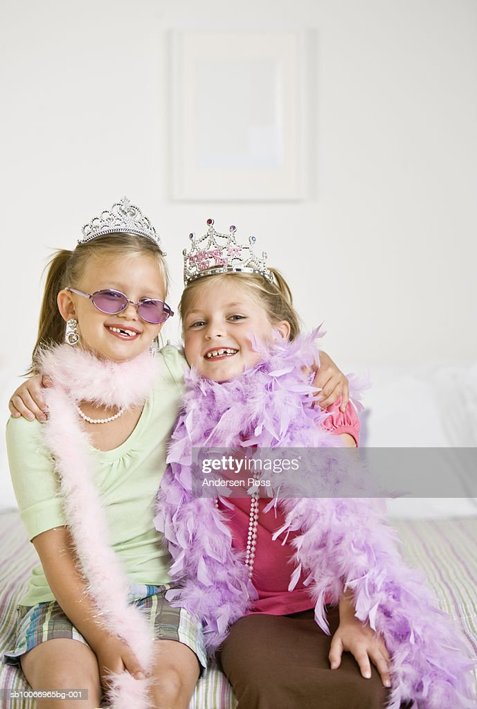 Two girls (6-7) playing dress up, portrait : Stock Photo