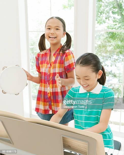 Two Girls Playing Music