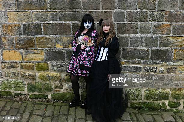 Two girls pose for the camera during the Goth weekend on April 26 2014 in Whitby England The Whitby Goth weekend began in 1994 and happens twice each...