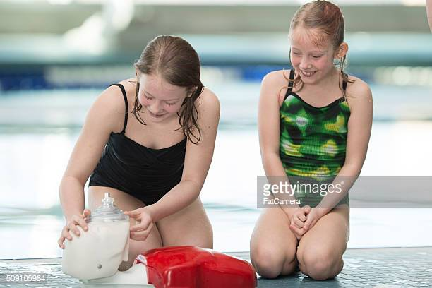Two Girls Practicing CPR